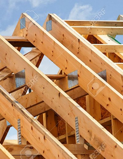 49974819-Standard-timber-framed-building-with-close-up-on-the-roof-trusses-Stock-Photo
